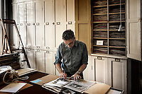 A botanist records and catalogues a species of plant into the archive of the Royal Botanical Gardens, Kew in London.