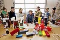 USA. California state. San Francisco. Potero Hill district. Ives Béhar (C) and part of his team stand in his offices at Fuseproject with some products he has designed. Yves Béhar (born 1967) is a Swiss designer, renowned entrepreneur, and sustainability advocate. He is the founder and principal designer of Fuseproject, an award-winning industrial design and brand development firm. Béhar is also Chief Creative Officer of the wearable technology company Jawbone, and Co-founder and Chief Creative Officer of August, a Smart Lock maker. Béhar's design work emphasizes the integration of commercial products with sustainability and social good. His clients have included Herman Miller, PUMA, MINI, See Better to Learn Better, General Electric, Swarovski, Samsung, Jimmyjane, and Prada. He is the chief industrial designer of One Laptop per Child (OLPC's) XO laptop, signing on with the project in 2005 and has been with the team since March 2006. This collaboration has led to two additional laptop prototypes, the OLPC XOXO and OLPC XO-3. In 2012 SodaStream International teamed with Béhar to introduce Source, a new home soda machine designed with a special emphasis on sustainability. 15.12.2014 © 2014 Didier Ruef