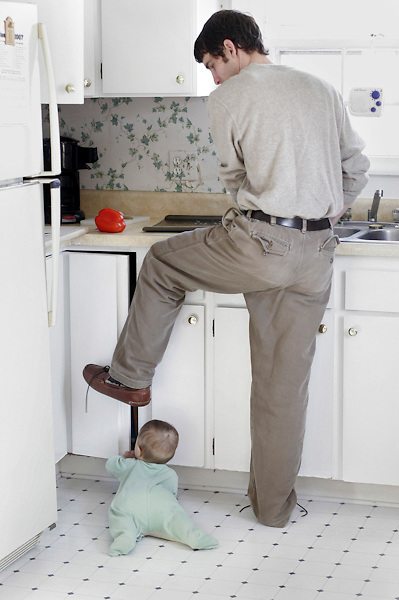 My husband tries to make lunch and keep the cupboard door shut from our older son's prying hands. Here he is seven months old.