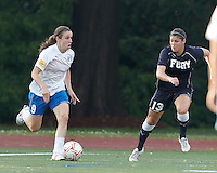 Boston Breakers midfielder Heather O'Reilly (9) comes out of the corner as New York Fury defender Brittany Taylor (13) defends. In a Women's Premier Soccer League Elite (WPSL) match, the Boston Breakers defeated New York Fury, 2-0, at Dilboy Stadium on June 23, 2012.