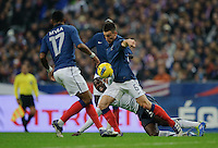 Yann Mvila of team France, Jozy Altidore of team USA and Laurent Konscielny of team France and Clint Dempsey of team USA (l-r) fight for the ball during the friendly match France against USA at the Stade de France in Paris, France on November 11th, 2011.