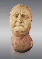 Roman sculpture of the Emperor Vitellius, excavated  from Althiburos sculpted circa 20 April 69-20 Dec 69AD. The Bardo National Museum, Tunis, Inv No: C.1784.   Against a grey background.