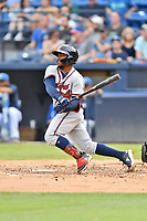 Rome Braves Justin Dean (5) swings at a pitch during a game against the Asheville Tourists at McCormick Field on July 18, 2019 in Asheville, North Carolina. The Tourists defeated the Braves 4-3. (Tony Farlow/Four Seam Images)