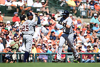 Detroit Tigers Nick Castellanos (9) high fives coach Dave Clark (25) after hitting a home run during a Spring Training game against the Baltimore Orioles on March 4, 2015 at Ed Smith Stadium in Sarasota, Florida.  Detroit defeated Baltimore 5-4.  (Mike Janes/Four Seam Images)