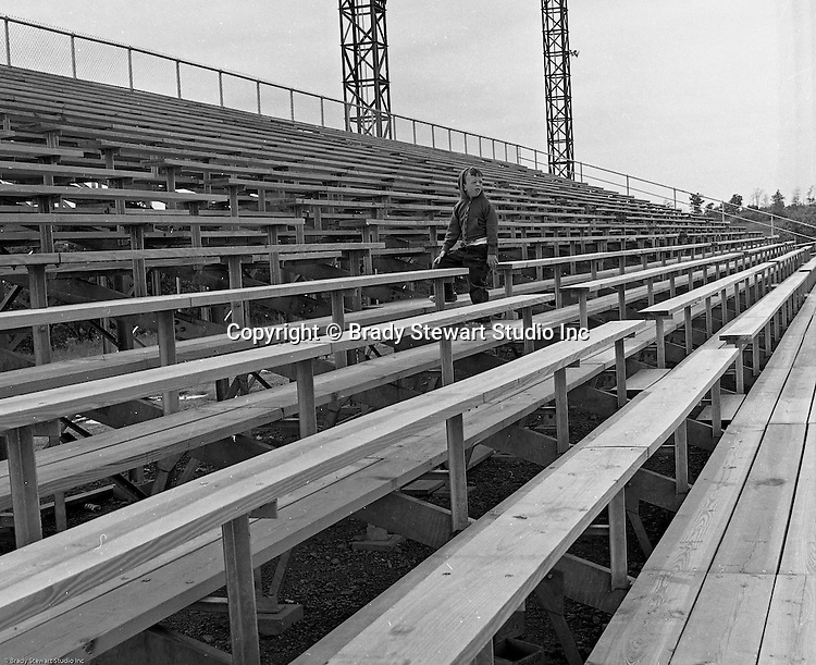 Bethel Park Senior High School:  View of the ongoing construction of the new High School Football Stadium.  Patrick Stewart was assisting Brady Stewart Jr. on the assignment. And Patrick probably spent more time in that stadium than anyone in Bethel Park history! The new Bethel Senior High School was dedicated on October 23, 1960, but the campus would not grow to its current size until seven years later. Phase II of the construction was completed in 1964 with the addition of another academic building and the industrial arts building. Phase III was completed in 1967 with the construction of the fourth academic building and a 6,300 seat football stadium and track, three tennis courts, seven basketball courts, and a baseball field.