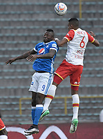 BOGOTA - COLOMBIA -16 -07-2017: Duver Riascos (Izq) jugador de Millonarios disputa el balón con William Tesillo (Der) jugador de Independiente Santa Fe durante partido por la fecha 2 de la Liga Aguila II 2017 jugado en el estadio Nemesio Camacho El Campin de la ciudad de Bogota. / Duver Riascos (L) player of Millonarios fights for the ball with William Tesillo (R) player of Independiente Santa Fe during match for the date 2 of the Liga Aguila II 2017 played at the Nemesio Camacho El Campin Stadium in Bogota city. Photo: VizzorImage / Gabriel Aponte / Staff.