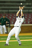 Third baseman Carlos Lopez #3 of the Wake Forest Demon Deacons settles under a pop fly against the Charlotte 49ers at Gene Hooks Field on March 22, 2011 in Winston-Salem, North Carolina.   Photo by Brian Westerholt / Four Seam Images