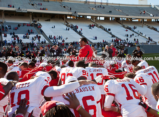 Houston Cougars team members have a quick prayer after the Ticket City Bowl game between the Penn State Nittany Lions and the University of Houston Cougars, played at the Cotton Bowl Stadium in Dallas, Texas. Houston defeats Penn State 30 to 14.