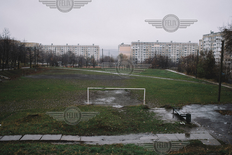A rain covered football pitch in the Ciocana district.
