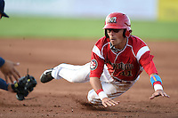 Batavia Muckdogs shortstop Aaron Blanton (11) slides into third during a game against the Jamestown Jammers on July 25, 2014 at Dwyer Stadium in Batavia, New York.  Batavia defeated Jamestown 7-2.  (Mike Janes/Four Seam Images)