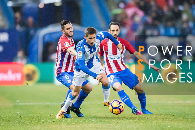 Alexander Szymanowski (c) of Deportivo Leganes battles for the ball with Jorge Resurreccion Merodio Koke (l), and Juan Francisco Torres Belen Juanfran of Atletico de Madrid during their La Liga match between Atletico de Madrid and Deportivo Leganes at the Vicente Calderón Stadium on 04 February 2017 in Madrid, Spain. Photo by Diego Gonzalez Souto / Power Sport Images