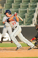 Stephen King #21 of the Hagerstown Suns follows through on his swing against the Kannapolis Intimidators at Fieldcrest Cannon Stadium August 8, 2010, in Kannapolis, North Carolina.  Photo by Brian Westerholt / Four Seam Images