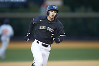 Patrick Frick (5) of the Wake Forest Demon Deacons hustles around third base against the Illinois Fighting Illini at David F. Couch Ballpark on February 16, 2019 in  Winston-Salem, North Carolina.  The Fighting Illini defeated the Demon Deacons 5-2. (Brian Westerholt/Four Seam Images)