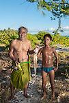 Father and son with their catch in Kiritimati in Kiribati.