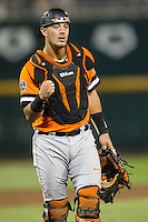 Oklahoma State Cowboys catcher Collin Theroux (16) signals out against the Arizona Wildcats during Game 6 of the NCAA College World Series on June 20, 2016 at TD Ameritrade Park in Omaha, Nebraska. Oklahoma State defeated Arizona 1-0. (Andrew Woolley/Four Seam Images)