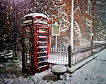 Snow falls around the telephone booth near City Hall in Oxford, Miss. on Sunday, January 9, 2011.