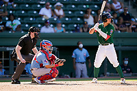Second baseman Nick Yorke (4) of the Greenville Drive in a game against the Hickory Crawdads on Sunday, August 29, 2021, at Fluor Field at the West End in Greenville, South Carolina. The catcher is David Garcia (13) and the umpire is Mitch Leikam. (Tom Priddy/Four Seam Images)