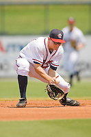 Second baseman Phil Gosselin #30 of the Rome Braves has trouble handling a ground ball against the Greenville Drive at State Mutual Stadium July 25, 2010, in Rome, Georgia.  Photo by Brian Westerholt / Four Seam Images