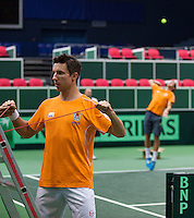29-01-2014,Czech Republic, Ostrava,  Cez Arena, Davis-cup Czech Republic vs Netherlands, practice, Igor Sijsling (NED)  in doing his warming up, in the back  Thiemo de Bakker (NED)<br /> Photo: Henk Koster