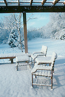 Patio and arbor covered in snow