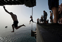 120323-N-DR144-1201 ARABIAN SEA (March 23, 2012) Sailors jump off aircraft elevator No. 4 during a swim call aboard the Nimitz-class aircraft carrier USS Carl Vinson (CVN 70). Carl Vinson and Carrier Air Wing (CVW) 17 are deployed to the U.S. 5th Fleet area of responsibility.  (U.S. Navy photo by Mass Communication Specialist 2nd Class James R. Evans/Released)