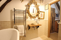 BNPS.co.uk (01202 558833)<br /> Pic: Cheffins/BNPS<br /> <br /> Pictured: There are two bathrooms<br /> <br /> Crime history fans can live in the home of notorious highwayman Dick Turpin for £1,950 a month.<br /> <br /> The infamous criminal ran a butcher's shop from this pretty thatched cottage before he joined a deer thief gang in the 1730s.<br /> <br /> Turpin was born opposite this house at the Bluebell Inn and staged cockfights in a grass area opposite the house which is still known as Turpin's ring.<br /> <br /> Robert Palmer bought the Grade II Listed Dick Turpin's Cottage in Hempstead, Essex, in 2012 and spent eight years gutting and refurbishing the house to make it more suitable for modern living.