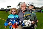 Enjoying their return to Tralee Parnells juvenile hurling training on Friday, Grace Ennis and Max Molloy with their grandfather John Walsh.