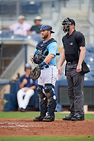 Charlotte Stone Crabs catcher Joey Roach (4) and umpire Louie Krupa during a Florida State League game against the Bradenton Maruaders on August 7, 2019 at Charlotte Sports Park in Port Charlotte, Florida.  Charlotte defeated Bradenton 2-0 in the first game of a doubleheader.  (Mike Janes/Four Seam Images)