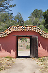Arched entrance door in Adobe wall with tile roof at Mission La Purisima State Historic Park, Lompoc, California.  Mission La Purisima, founded in 1787 by Franciscan Padre Presidente Fermin Francisco Lasuen. La Purisima was the eleventh mission of the twenty-one Spanish Missions established in what later became the state of California.
