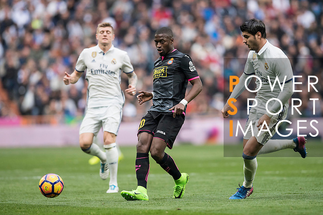 Toni Kroos of Real Madrid  fights for the ball with Papakouli Diop of RCD Espanyol  Real Madrid vs RCD Espanyol, a La Liga match at the Santiago Bernabeu Stadium on 18 February 2017 in Madrid, Spain. Photo by Diego Gonzalez Souto / Power Sport Images