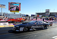 Oct. 30, 2011; Las Vegas, NV, USA: NHRA pro mod driver Leah Pruett (near lane) races alongside Peter Farber during the Big O Tires Nationals at The Strip at Las Vegas Motor Speedway. Mandatory Credit: Mark J. Rebilas-