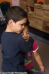 Education Preschool 3-4 year olds boy hugging classmate