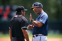 GCL Braves manager Nestor Perez (4) argues a call with umpire Scott Molloy during a game against the GCL Blue Jays on August 5, 2016 at ESPN Wide World of Sports in Orlando, Florida.  GCL Braves defeated the GCL Blue Jays 9-0.  (Mike Janes/Four Seam Images)