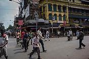 Pedestrians cross the junction outside the Mullik Ghat Flower market in Howrah, Kolkata, West Bengal  on Friday, May 26, 2017. Photographer: Sanjit Das