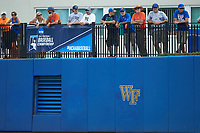 Fans stand along the railing down the right field line during the game between the Wake Forest Demon Deacons and the Florida Gators in Game Two of the Gainesville Super Regional of the 2017 College World Series at Alfred McKethan Stadium at Perry Field on June 11, 2017 in Gainesville, Florida.  (Brian Westerholt/Four Seam Images)
