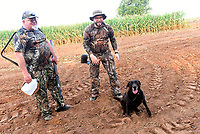 Russell Pardue (left) of Tulsa, Okla. and Craig Pardue of Fayetteville wrap up their opening-morning dove hunt on Sept. 4 2021 near Prairie Grove with their retriever, Brooke. <br />(NWA Democrat-Gazette/Flip Putthoff?