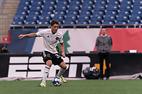 FOXBOROUGH, UNITED STATES - MAY 28: Ignacio Poplawski #34 of Fort Lauderdale CF controls the ball during a game between Fort Lauderdale CF and New England Revolution II at Gillette Stadium on May 28, 2021 in Foxborough, Massachusetts.