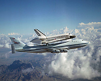 The Space Shuttle Discovery hitched a ride on NASA's modified Boeing 747 Shuttle Carrier Aircraft for the flight from the Dryden Flight Research Center in California, to Kennedy Space Center, Florida, on August 19, 2005.<br /> <br /> Image Credit: NASA/Lori Losey