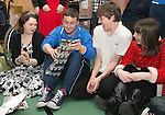 St Johnstone players visit Fairview School in Perth.....19.12.13<br /> Tom Scobbie is pictured palying pass the parcel with from left, Holly Sandeman, Gus Pettitt and Niamh Sandeman.<br /> Picture by Graeme Hart.<br /> Copyright Perthshire Picture Agency<br /> Tel: 01738 623350  Mobile: 07990 594431