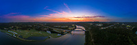 A summer's jewel, in the aerial perspective view the sunset came across the Austin Country Club's Golf Course and 360 Bridge, the gorgeous light of pink and orange hues make for a magical sunset.