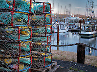 Crab pots and boats at Newport Harbor on the Yaquina River, Oregon