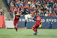FOXBOROUGH, MA - SEPTEMBER 21: Brooks Lennon #12 of Real Salt Lake, Teal Bunbury #10 of New England Revolution and Erik Holt #20 of Real Salt Lake compete for a high ball during a game between Real Salt Lake and New England Revolution at Gillette Stadium on September 21, 2019 in Foxborough, Massachusetts.