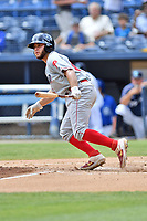 Lakewood BlueClaws Juan Aparicio (18) runs to first base during a game against the Asheville Tourists at McCormick Field on August 4, 2019 in Asheville, North Carolina. The Tourists defeated the BlueClaws 13-6. (Tony Farlow/Four Seam Images)