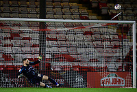 Lincoln City's Ethan Ross watches as a penalty from Manchester City U21's Alpha Dionkou goes over the crossbar in the penalty shoot out<br /> <br /> Photographer Chris Vaughan/CameraSport<br /> <br /> EFL Papa John's Trophy - Northern Section - Group E - Lincoln City v Manchester City U21 - Tuesday 17th November 2020 - LNER Stadium - Lincoln<br />  <br /> World Copyright © 2020 CameraSport. All rights reserved. 43 Linden Ave. Countesthorpe. Leicester. England. LE8 5PG - Tel: +44 (0) 116 277 4147 - admin@camerasport.com - www.camerasport.com