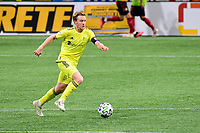 ATLANTA, GA - AUGUST 22: Dax McCarty #6 dribbles the ball during a game between Nashville SC and Atlanta United FC at Mercedes-Benz Stadium on August 22, 2020 in Atlanta, Georgia.