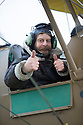 """13/03/15<br /> <br /> Colin Temple-Smith gets ready to check the Tiger Moth's performance from the front passenger seat on its first flight.<br /> <br /> ***FULL STORY HERE:   http://www.fstoppress.com/articles/tiger-moth-restorations/    ****<br /> <br /> You may remember spending hours toiling over Airfix models, painstakingly following intricate instructions and trying not to glue your fingers together before painting your own miniature version of one of the RAF's or Luftwaffe's finest aircraft. Then spare a thought for one man who has just helped to restore and put together one World War Two Tiger Moth and is about to start piecing together another FOUR aircraft that were discovered in bits in a barn.<br /> <br /> Sixty-year-old Colin Temple-Smith – who wears a moustache that any Wing Commander would be proud of – has spent a lifetime restoring vintage cars and motorcycles and recently quit his job as a window fitter to help re-build the five bi-planes that will become part of a growing fleet of Tiger Moths at Derbyshire based Blue Eye Aviation.<br /> <br /> Today saw the first of the fully-restored five aircraft take to the skies.<br /> <br /> """"It's just like working on old bikes and cars, although they're a lot more fragile"""" explained Colin, whose wife runs the Aviators Café at Darley Moor Airfield near Ashbourne.<br /> <br /> """"When I was a teenager I used to be a member of a modelling club, making flying models from wood and canvas. They're very similar to build – it's really just the size that's changed with these.<br /> <br /> All Rights Reserved: F Stop Press Ltd. +44(0)1335 418629   www.fstoppress.com."""