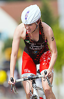 01 SEP 2013 - SARTROUVILLE, FRA - Great Britain's Lucy Hall racing for Brive Limousin Triathlon climbs a hill on the bike on her way to taking third place at the women's Grand Prix de Triathlon de Sartrouville in Sartrouville, France (PHOTO COPYRIGHT © 2013 NIGEL FARROW, ALL RIGHTS RESERVED)