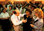 Revd George Canty, faith healer performing acts of healing at Kensington Temple at Pentecostal church in the Notting Hill area of London 1990s.