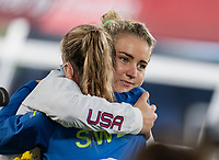 YOKOHAMA, JAPAN - AUGUST 6: Kosovare Asllani #9 of Sweden hugs Lindsey Horan #9 of the USWNT at International Stadium Yokohama on August 6, 2021 in Yokohama, Japan.