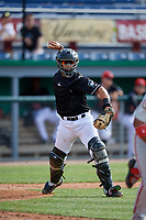 Batavia Muckdogs catcher Igor Baez (6) throws to first base during a NY-Penn League game against the Auburn Doubledays on June 19, 2019 at Dwyer Stadium in Batavia, New York.  Batavia defeated Auburn 5-4 in eleven innings in the completion of a game originally started on June 15th that was postponed due to inclement weather.  (Mike Janes/Four Seam Images)